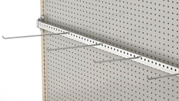 Left angle view of empty white Magna-Bar gondola shelving system with removable pegboard hooks